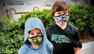 children wearing face masks